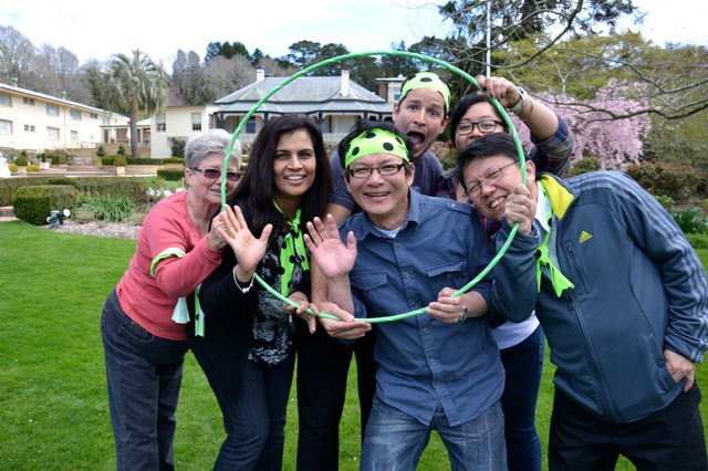 Corporate groups bonding together with fun games in a conference
