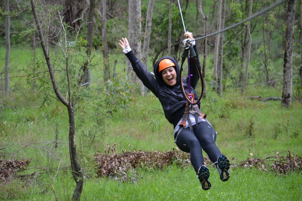 Lady yahooing on the flying fox zip line on a Sydney team Building Activities day.